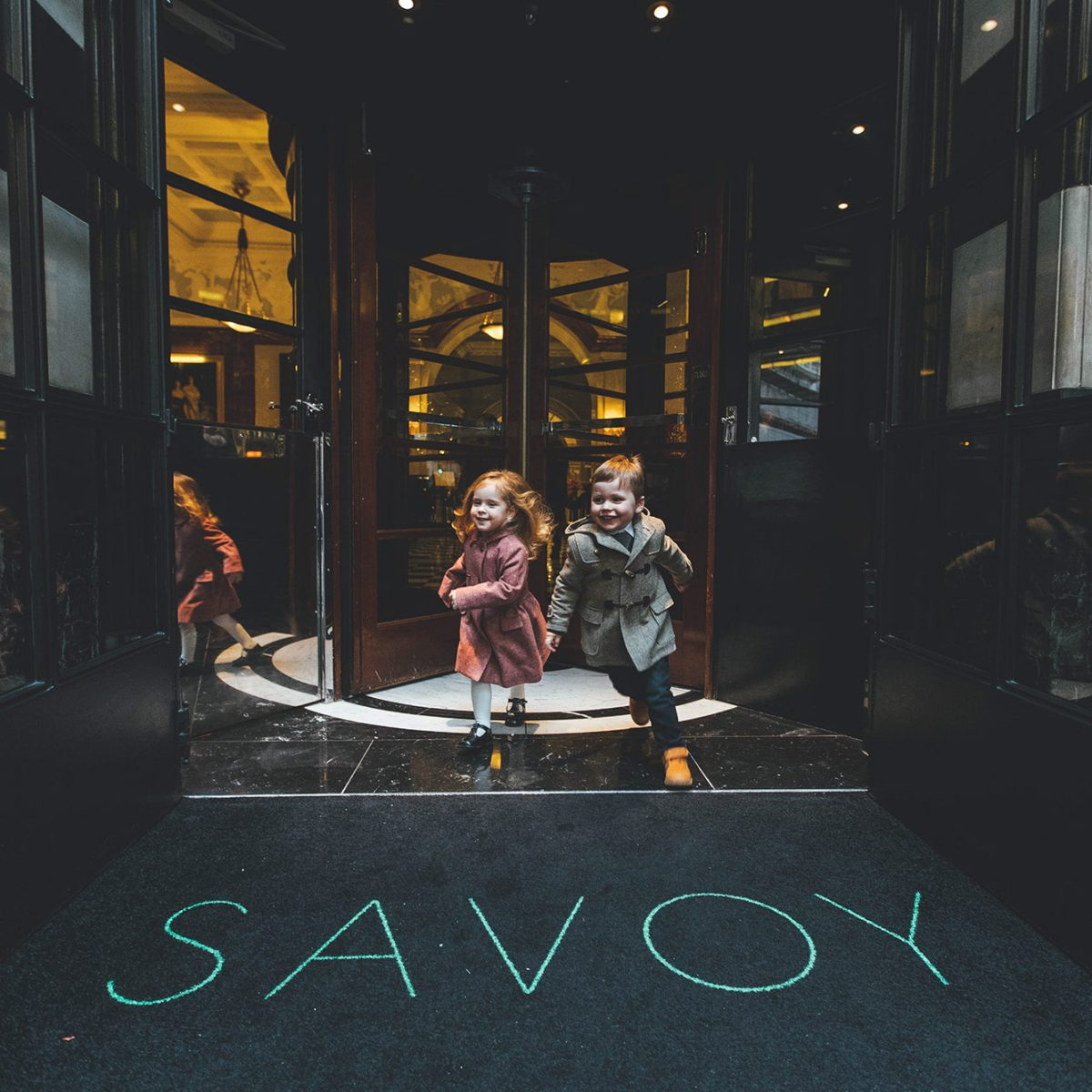 Children running out of The Savoy entrance
